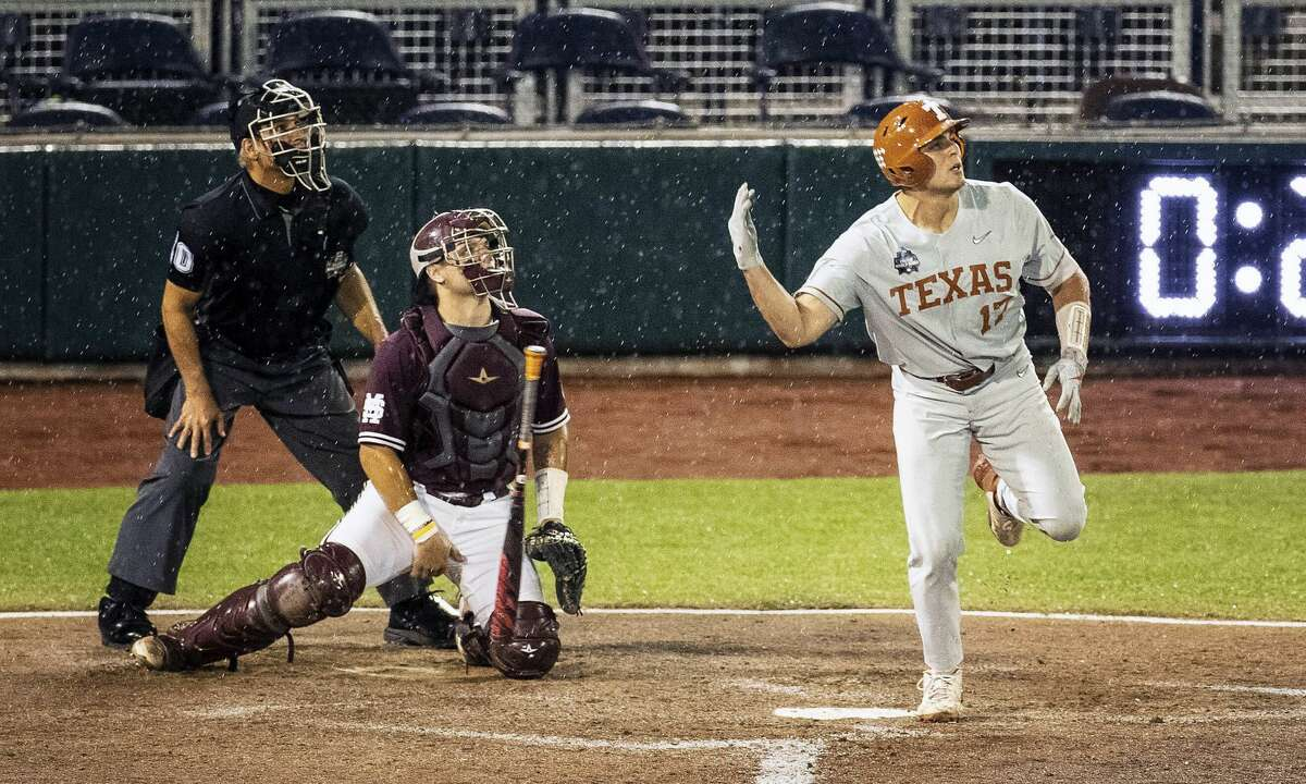 Texas's Ivan Melendez flips the bat after he hit a three-run home run against Mississippi State during the ninth inning of a baseball game in the College World Series Friday, June 25, 2021, at TD Ameritrade Park in Omaha, Neb. (Chris Machian/Omaha World-Herald via AP)