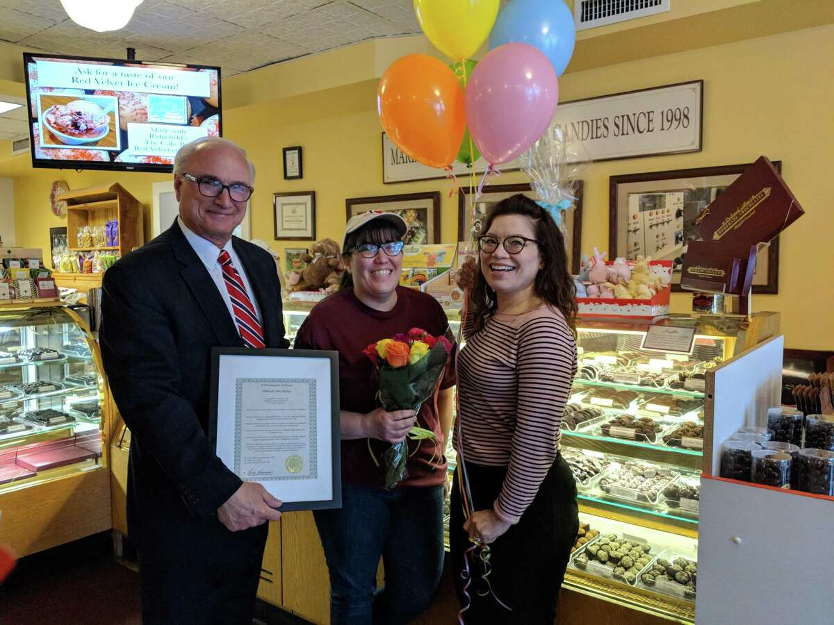In 2019, Deborah Ann Backes, center, received the Woman of the Year award in Ridgefield. First Selectman Rudy Marconi, left, and Chamber Executive Director Kim Bova presented her with the award.