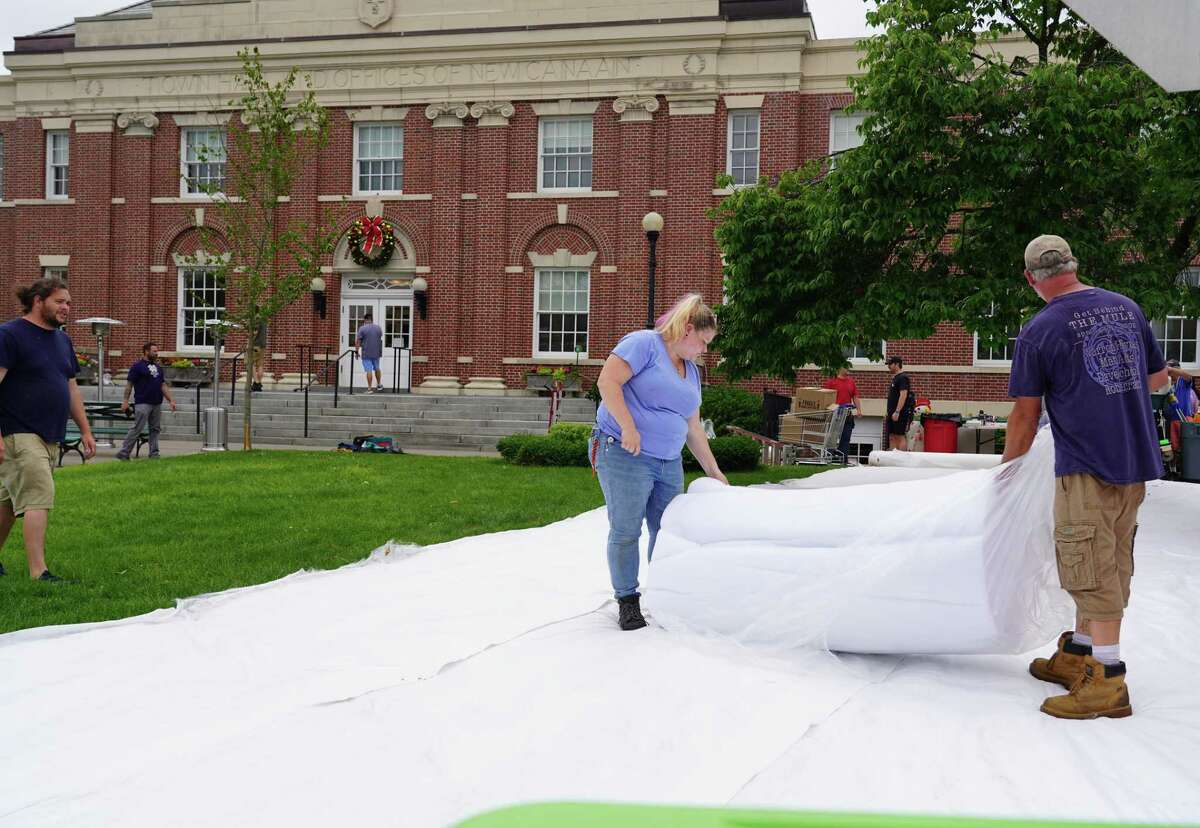 """Christmas in June has come to the front lawn of New Canaan Town Hall, which will serve as a movie set for a Netflix movie, """"The Noel Diary"""" with actor Justin Hartley. Special effects professionals Frank Dawid and Kristin Kreho put down the snow on Friday, June 25."""