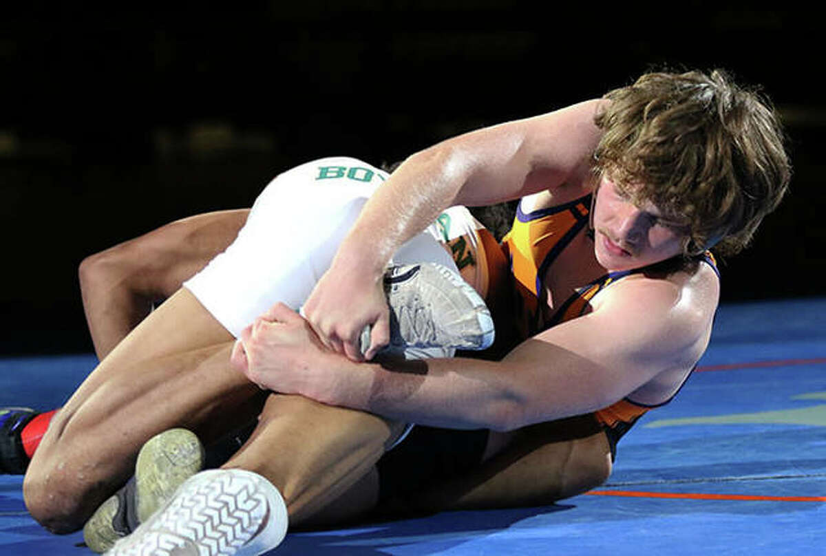 CM's Abe Wojcikiewicz (right) works on Rockford Boylan's Dathan Wickson during their 160-pound title match at the IWCOA Class 2A state meet Friday night in Springfield.
