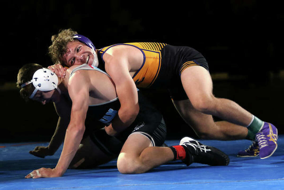 CM's Caleb Tyus (right) is in control against Woodstock Marian Central Catholic's Chris Moore in the 138-pound title match at the IWCOA Class 2A state meet Friday night in Springfield.