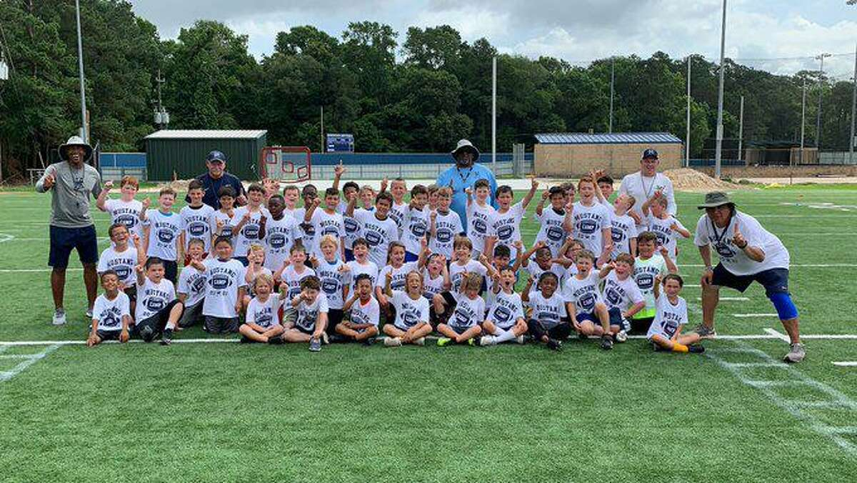 The Kingwood football coaches worked with the future Mustangs during summer camp.