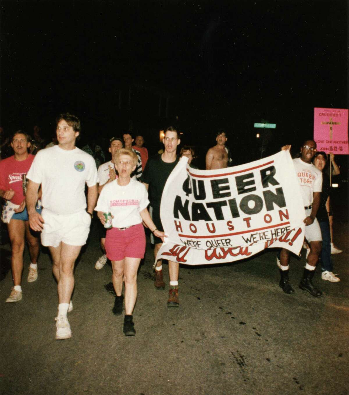 """07/11/1992 - Queer Nation members and supporters march in the Montrose area Saturday night in commemoration of Paul Broussard, who was killed in a gay-bashing hate crime in 1991. Called """"Take Back the Streets II,"""" the march started at 9 pm."""