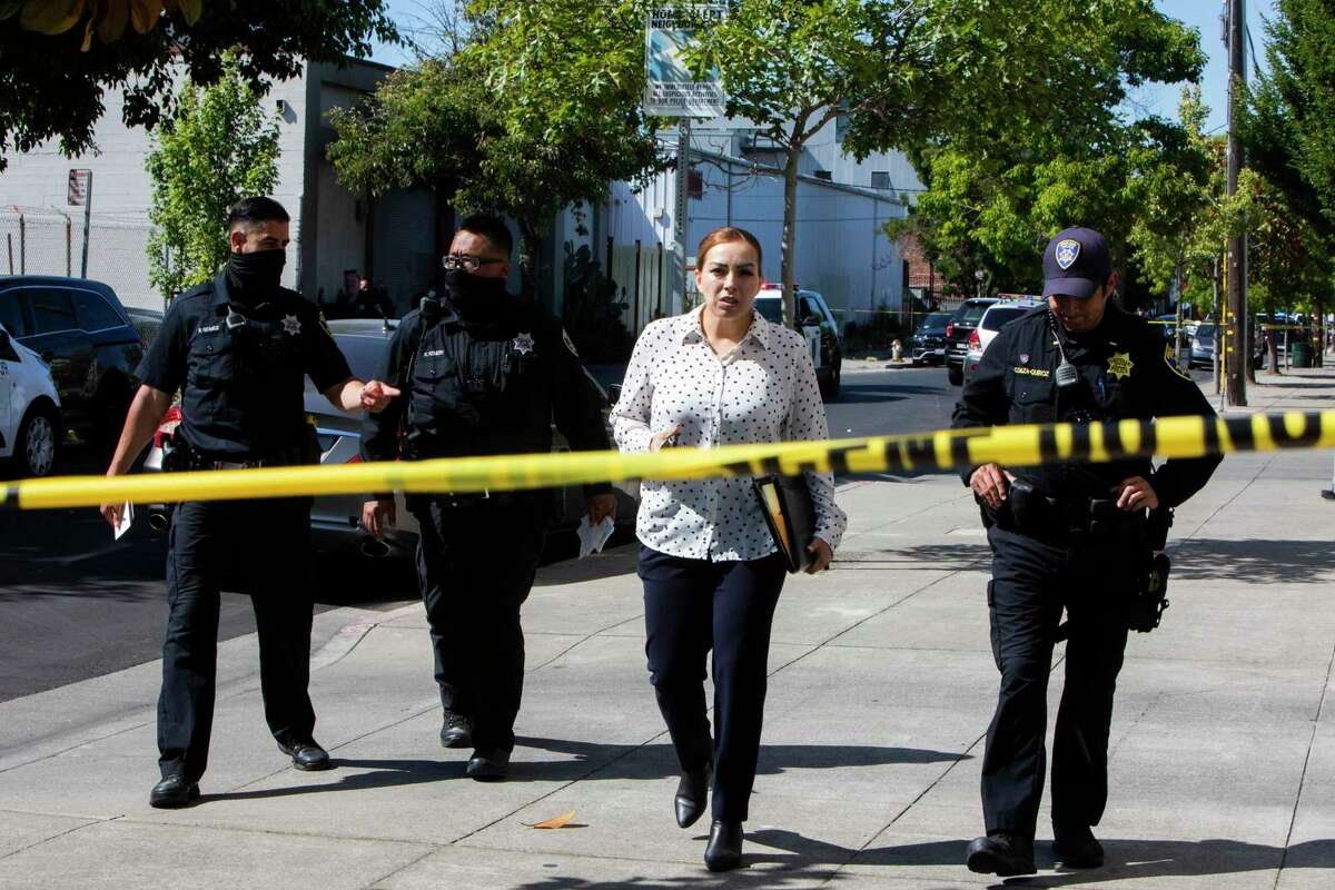 Oakland Police and homicide investigators leave the scene of a homicide on the 2200 block of Chestnut Street in Oakland on Friday.