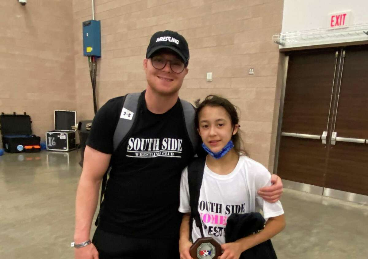 Kayla Batres at the 2021 USA women's freestyle nationals (Irving, TX) with coach Brandon Fulco.