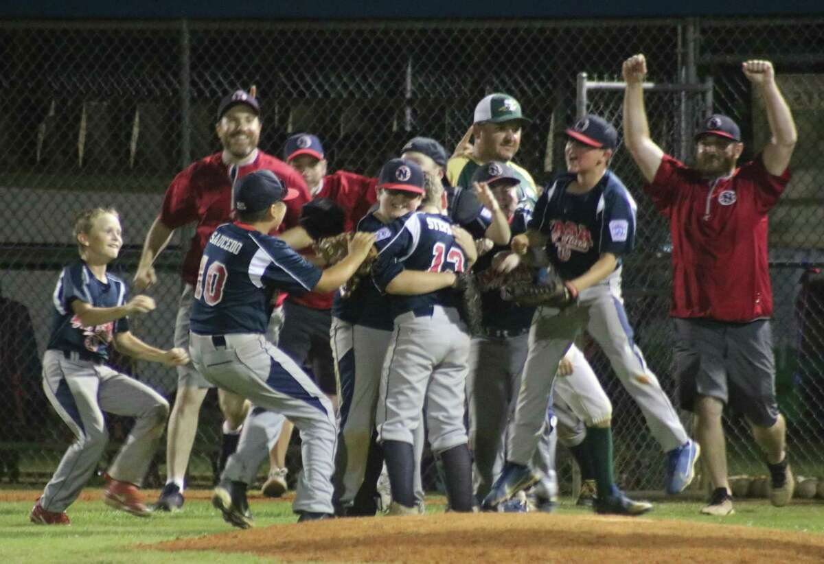 The NASA Area Little League 11-year-old all-stars mob pitcher Henry Stephens, beginning their celebration of overcoming an 8-0 deficit to win the District 14 crown Friday night.