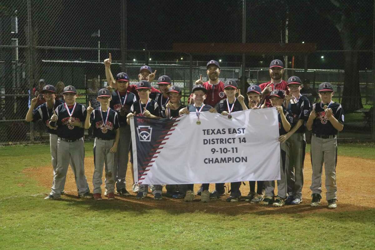 The NASA Area Little League 11-year-old all-stars and coaching staff pose with their very hard-earned district championship flag Friday night, pounding out 18 hits to get the job done.