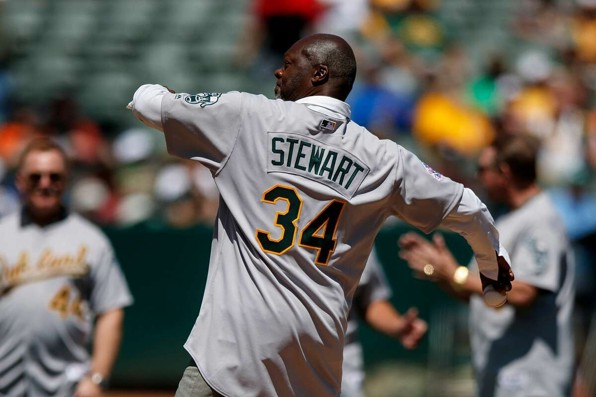 Former pitcher Dave Stewart of the Oakland Athletics throws out the ceremonial first pitch during a ceremony honoring the 1989 World Series championship team before the game against the San Francisco Giants at the RingCentral Coliseum on August 25, 2019 in Oakland.