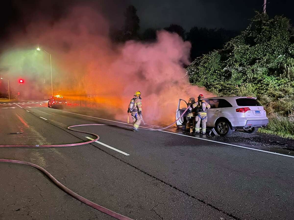 South Windsor firefighters battled a car fire on the exit 3 off-ramp of I-291.