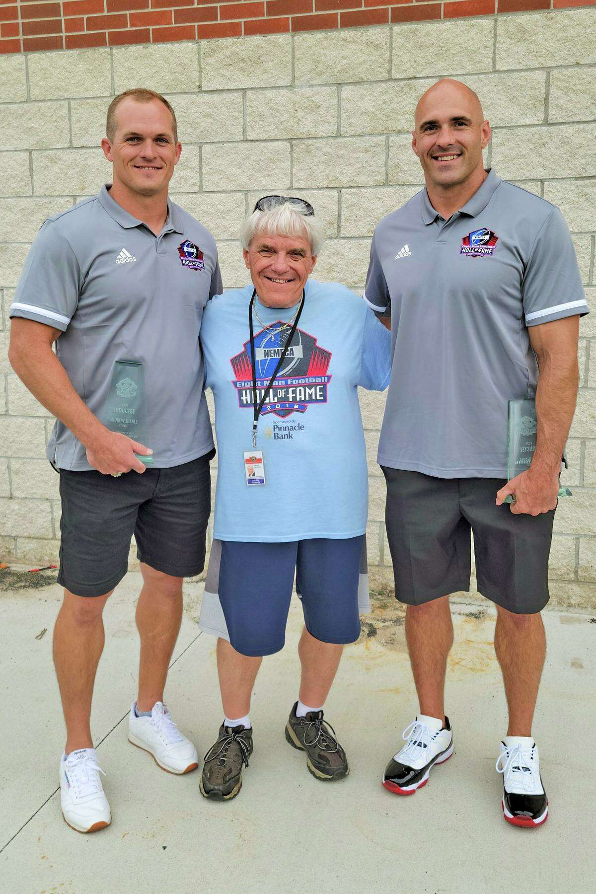 Nebraska Eight Man Football Hall of Fame inductees Cypress Ridge High School head football coach and campus athletic coordinator Andrew Shanle Andrew Shanle, left, and his brother, Scott, right, pose with veteran sports reporter and 2018 hall of fame inductee Bobby Mills.