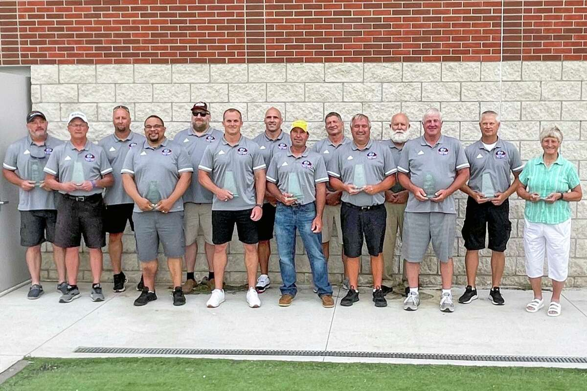 Cypress Ridge High School head football coach and campus athletic coordinator Andrew Shanle, sixth from left, poses with his brother, Scott, seventh from left, and the other 12 members of the Nebraska Eight Man Football Hall of Fame Class of 2020 who were honored during halftime of the 43rd NEMFCA Sertoma All-Star Game on June 19.