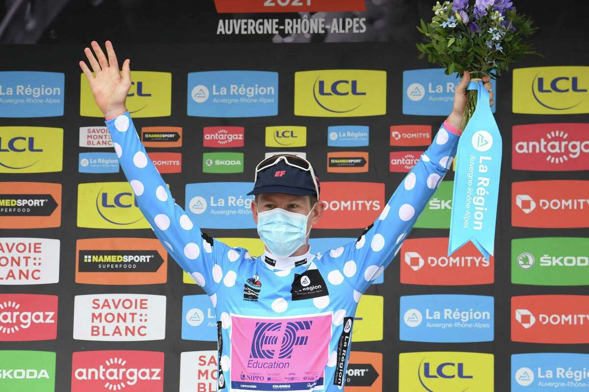 Team Education First's Lawson Craddock of US celebrates his best climber's polka dot jersey on the podium at the end of the seventh stage of the 73rd edition of the Criterium du Dauphine cycling race, a 171km between Saint-Martin-Le-Vinoux and La Plagne on June 5, 2021. (Photo by Alain JOCARD / AFP) (Photo by ALAIN JOCARD/AFP via Getty Images)