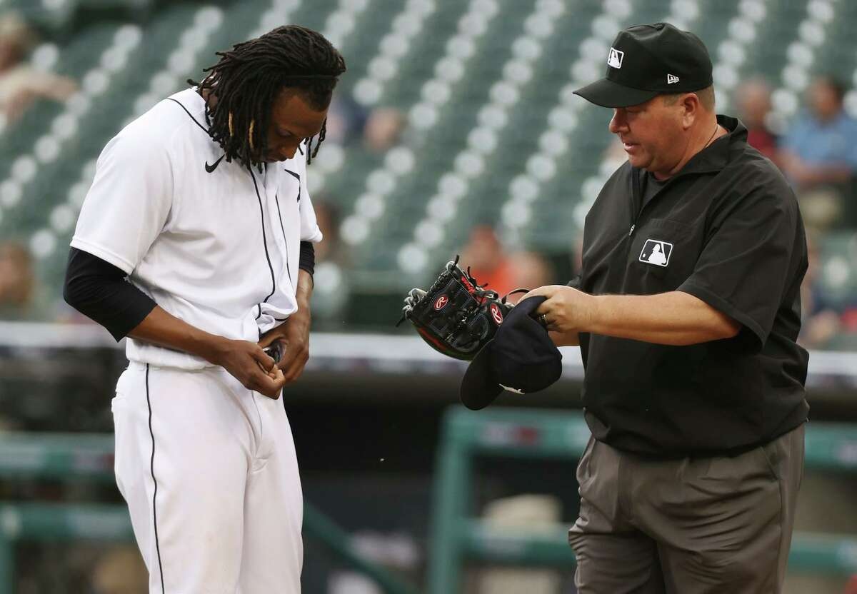 Detroit Tigers pitcher Jose Urena is checked for illegal substances by first base umpire Sam Holbrook after pitching the first inning against the Houston Astros on Thursday. Urena stayed in the game.