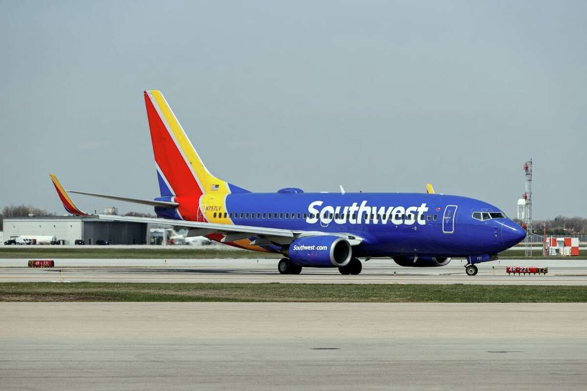 A Southwest Airlines jet taxis to the gate after landing at Midway International Airport in Chicago, Illinois, on April 6, 2021.