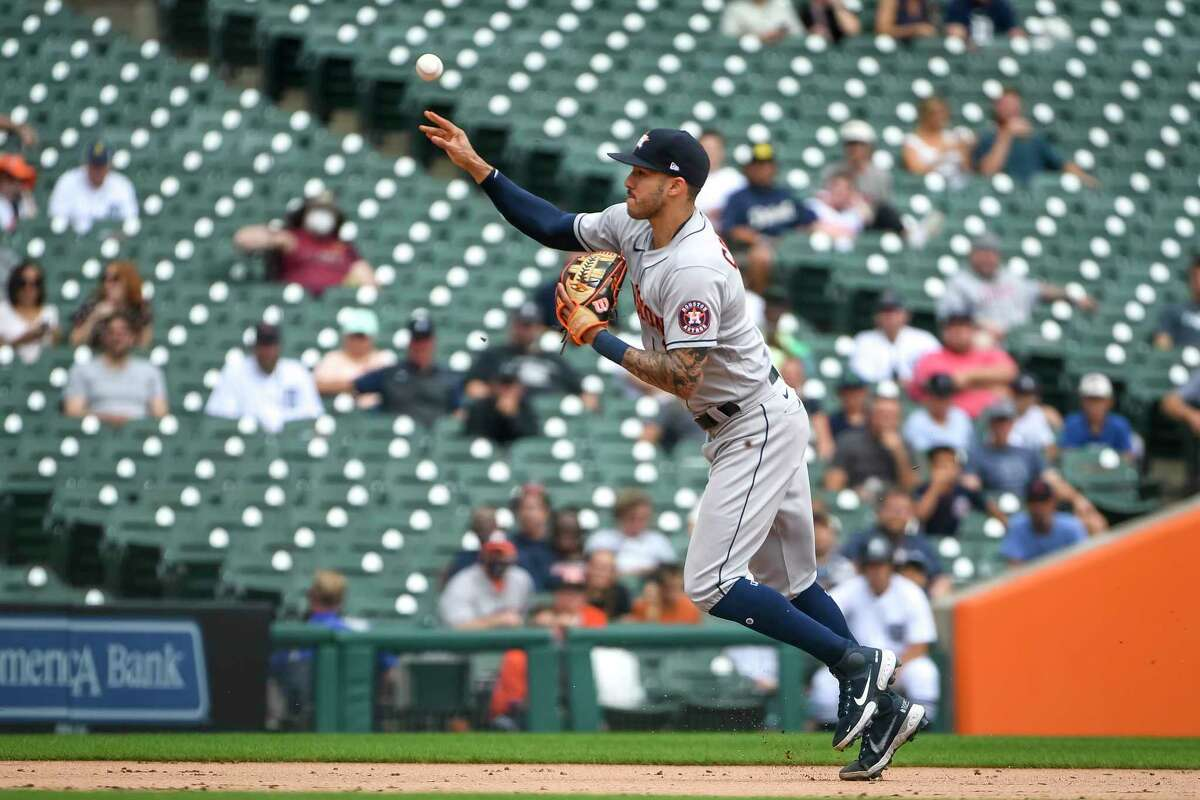 DETROIT, MICHIGAN - JUNE 26: Carlos Correa #1 of the Houston Astros throws to third base against the Detroit Tigers during the bottom of the third inning in game one of a doubleheader at Comerica Park on June 26, 2021 in Detroit, Michigan.