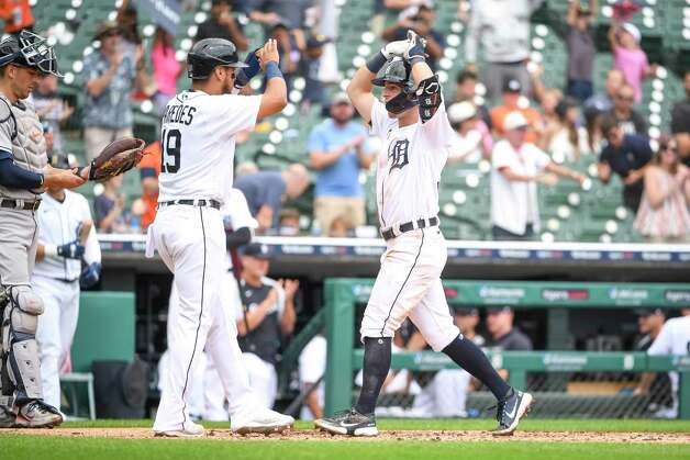 DETROIT, MICHIGAN - JUNE 26: Isaac Paredes #19 of the Detroit Tigers and Zack Short #59 of the Detroit Tigers celebrate Shorts homer and Paredes scoring during the bottom of the fifth inning in game one of a doubleheader at Comerica Park on June 26, 2021 in Detroit, Michigan. Photo: Nic Antaya, Getty Images / 2021 Getty Images