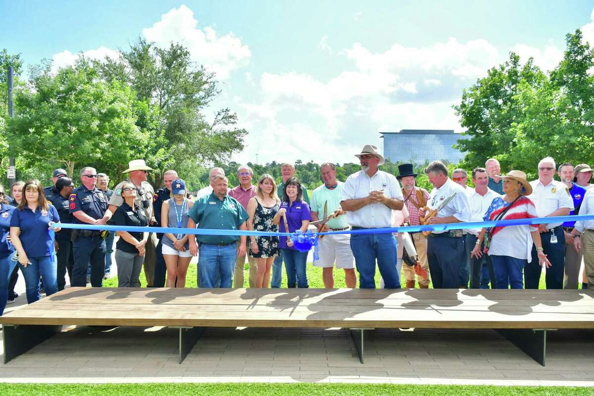 Members of the community gather at CityPlace at Springwoods Village on June 26, 2021, for a ribbon cutting to celebrate the completion of a new 3-mile section of the Spring Creek Greenway linking Rothwood Park to Springwoods Village.