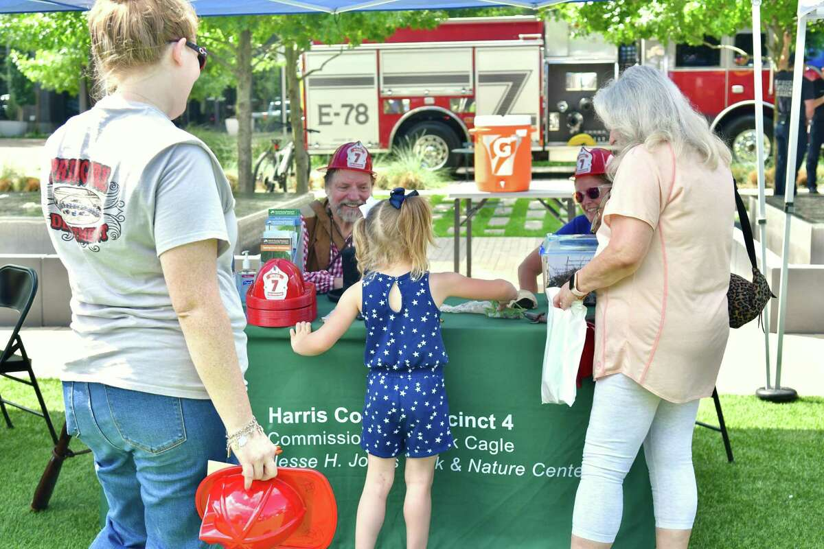 Families and Pct. 4 representatives enjoy the Spring Creek Greenway trail extension celebration at CityPlace in Springwoods Village Saturday, June 26, 2021.