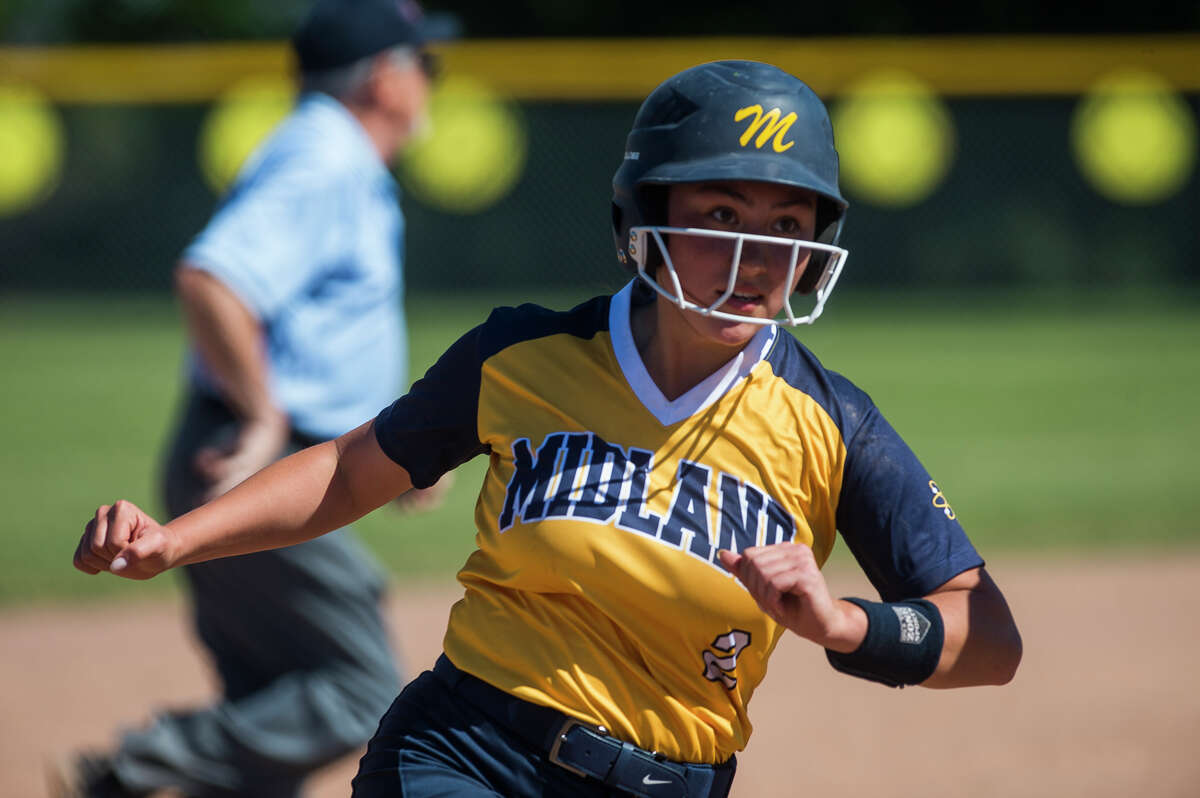 Midland's Kiara Kiely rounds third base during a June 5, 2021 district semifinal against Dow High.