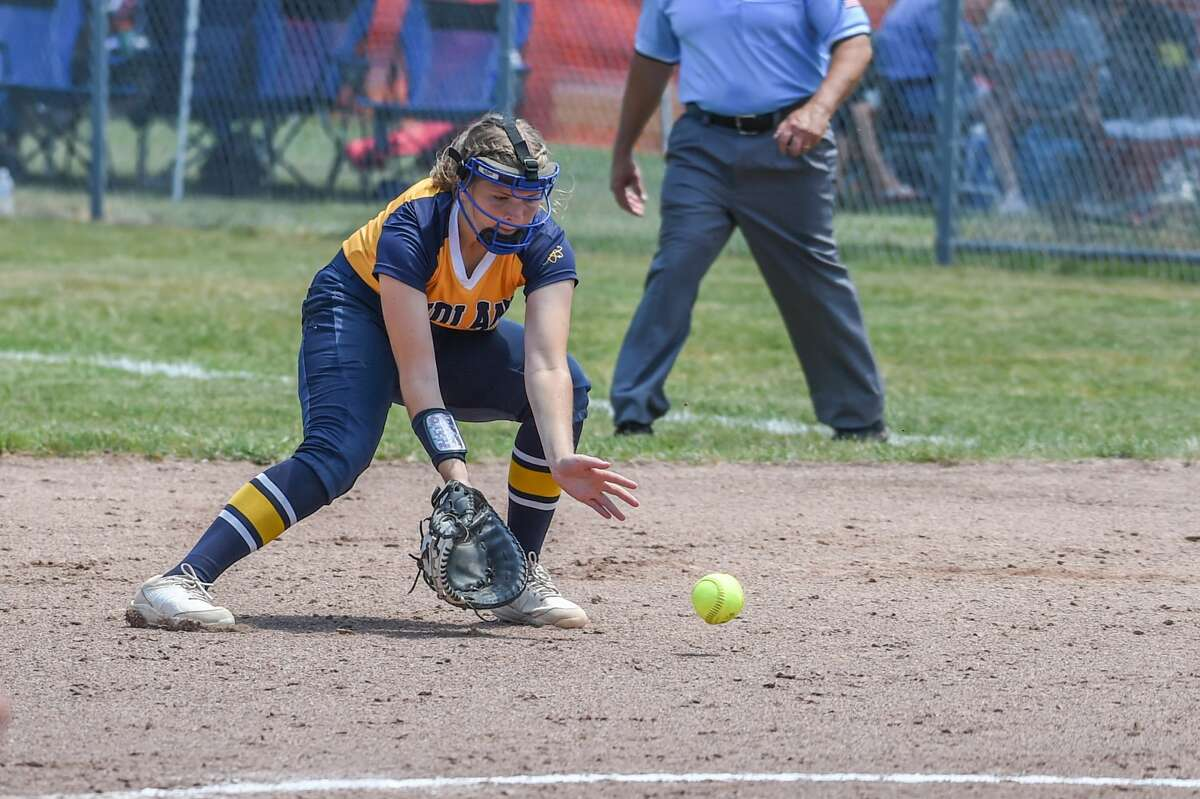 Midland High's Morgan Williams fields a grounder during a June 12, 2021 regional semifinal against Traverse City West.