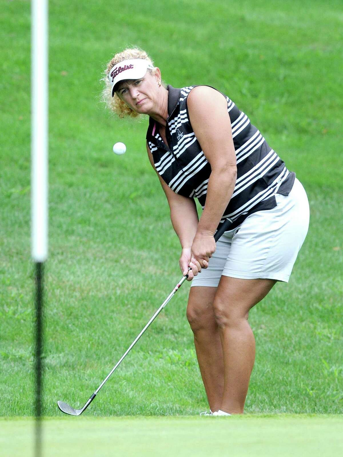 Jen Holland chips onto the fourth hole during the 2010 Connecticut State Amateur Golf Championship. Holland is among the state golfers competing in the New England Women's Amateur this week in Rhode Island.