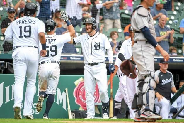 DETROIT, MICHIGAN - JUNE 26: Zack Short #59 of the Detroit Tigers high fives Robbie Grossman #8 of the Detroit Tigers after Shorts homer during the bottom of the fifth inning in game one of a doubleheader at Comerica Park on June 26, 2021 in Detroit, Michigan. Photo: Nic Antaya, Getty Images / 2021 Getty Images