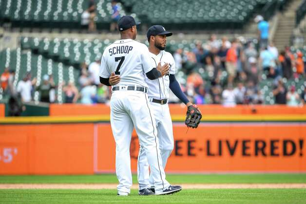 DETROIT, MICHIGAN - JUNE 26: Jonathan Schoop #7 of the Detroit Tigers and Jeimer Candelario #46 of the Detroit Tigers celebrate after defeating the Houston Astros in game one of a doubleheader at Comerica Park on June 26, 2021 in Detroit, Michigan. Photo: Nic Antaya, Getty Images / 2021 Getty Images