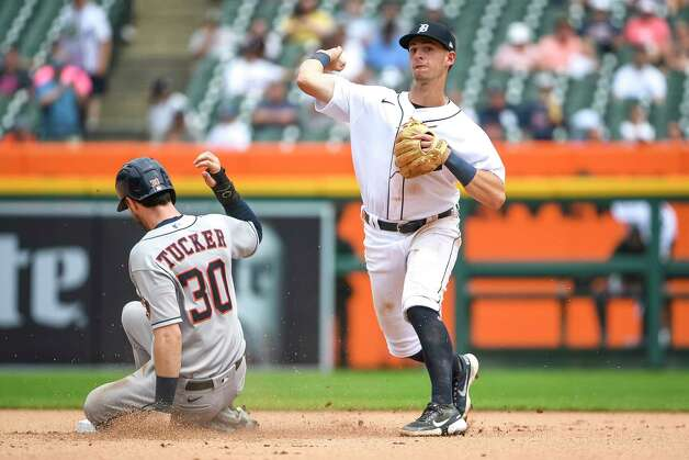 DETROIT, MICHIGAN - JUNE 26: Kyle Tucker #30 of the Houston Astros is out at second as Zack Short #59 of the Detroit Tigers throws to first base during the top of the sixth inning in game one of a doubleheader at Comerica Park on June 26, 2021 in Detroit, Michigan. Photo: Nic Antaya, Getty Images / 2021 Getty Images