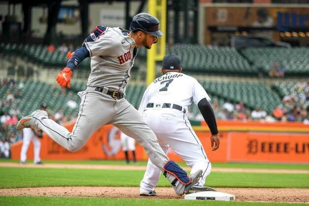 DETROIT, MICHIGAN - JUNE 26: Yuli Gurriel #10 of the Houston Astros singles on a ground ball against Jonathan Schoop #7 of the Detroit Tigers during the top of the fifth inning in game one of a doubleheader at Comerica Park on June 26, 2021 in Detroit, Michigan. Photo: Nic Antaya, Getty Images / 2021 Getty Images