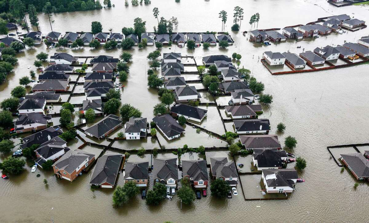 A neighborhood is inundated by floodwaters from Hurricane Harvey on Tuesday, Aug. 29, 2017, in Spring.
