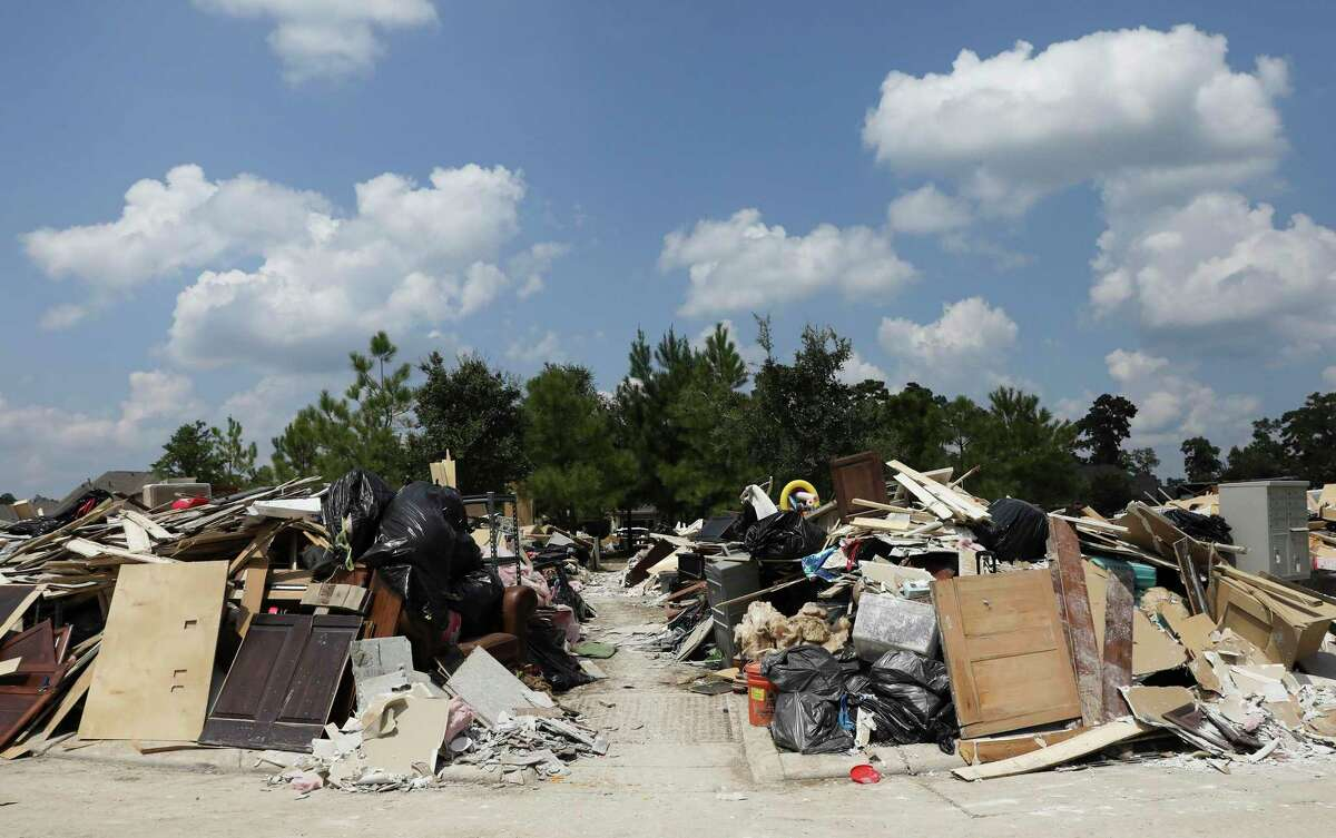 Piles of debris taken from homes that were damaged by Hurricane Harvey in the Barrington neighborhood in Kingwood build up Monday, Sept. 4, 2017.