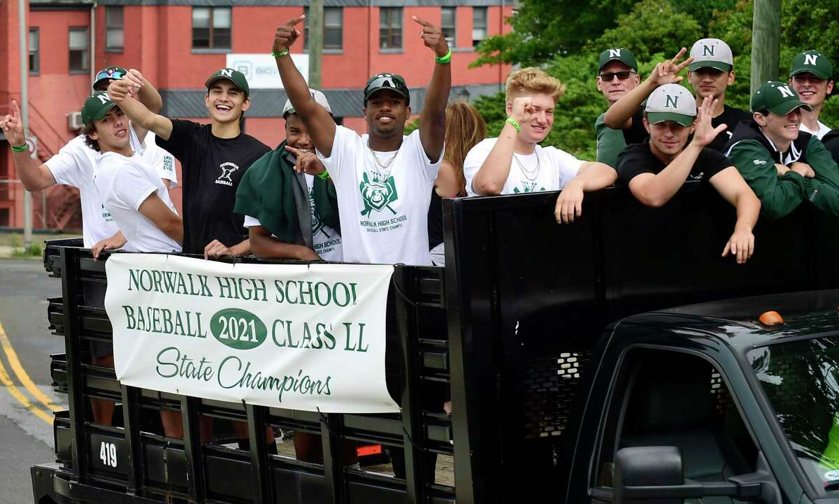 The Norwalk High School baseball state champions participate in a parade through the city ending at reception at Norwalk Town Green Saturday, June 26, 2021, in Norwalk, Conn.