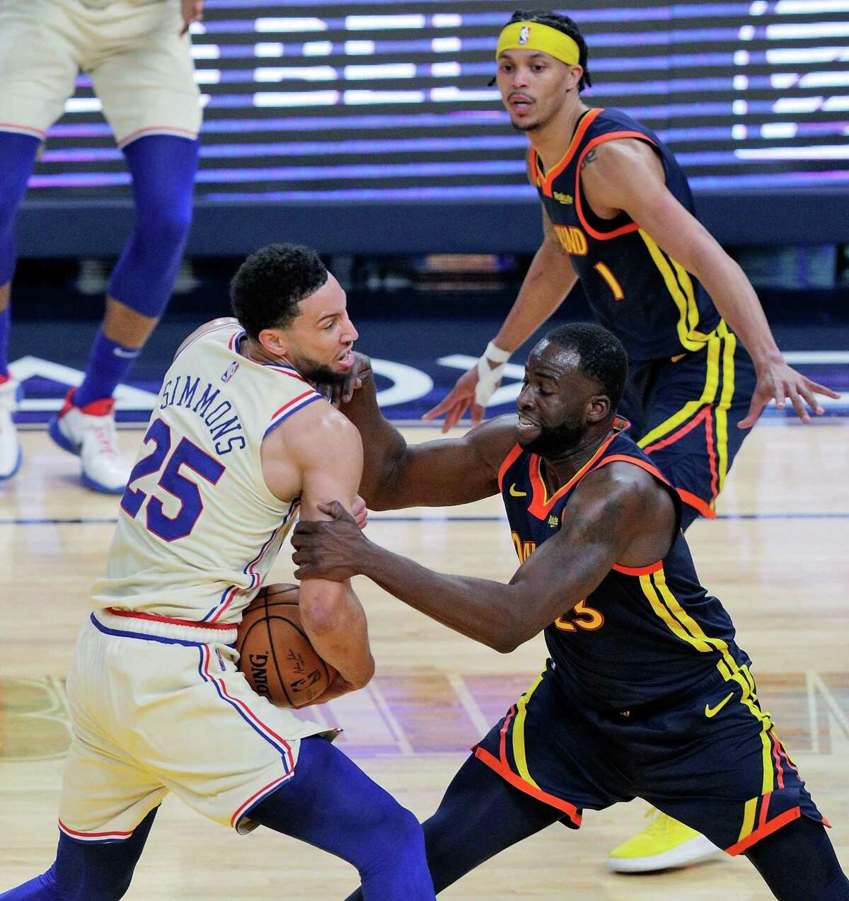 Draymond Green (23) fouls Ben Simmons (25) in the first half as the Golden State Warriors played the Philadelphia 76ers at Chase Center in San Francisco, Calif., on Tuesday, March 23, 2021.