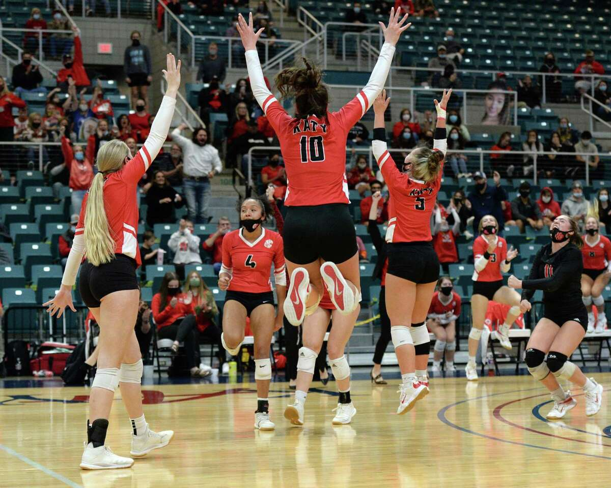 The Katy Tigers celebrate a point during the first set of the 6A Region 3 Championship game against the Seven Lakes Spartans on Friday, December 4, 2020 at Leonard Merrell Center, Katy, TX.