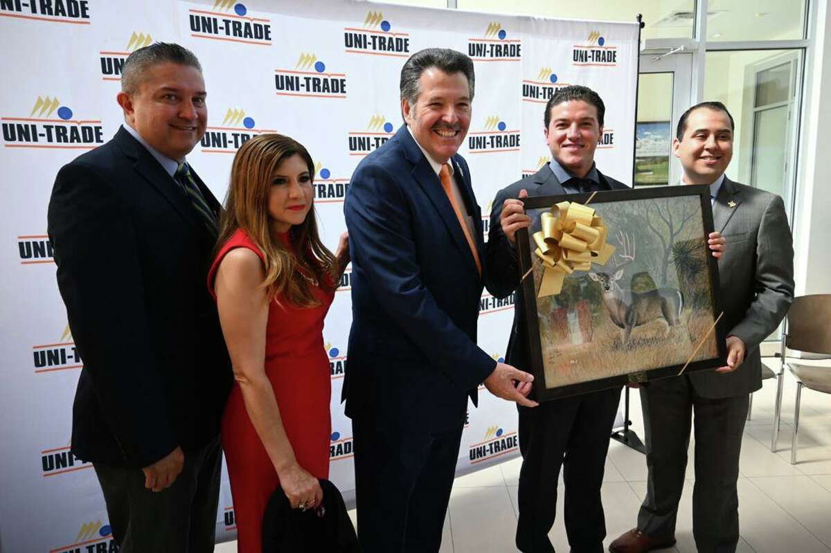 Laredo Mayor Pete Saenz gives a gift to the visiting Nuevo León Governor-elect Samuel García Sepúlveda at an event located at Uni-Trade Stadium alongside other Laredo officials and members of the business community, as trade, economic growth and details over the Gloria-Colombia highway plan were discussed.