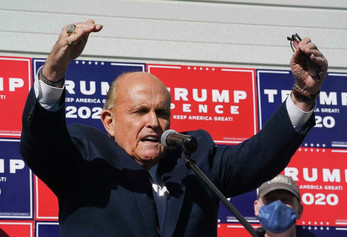 In this file photo taken on November 07, 2020, attorney for President Donald Trump, Rudy Giuliani, speaks at a news conference in the parking lot of a landscaping company in Philadelphia. A New York court suspended Giuliani's law license on June 24, 2021, for claiming that former Trump lost last year's presidential election because of fraud.