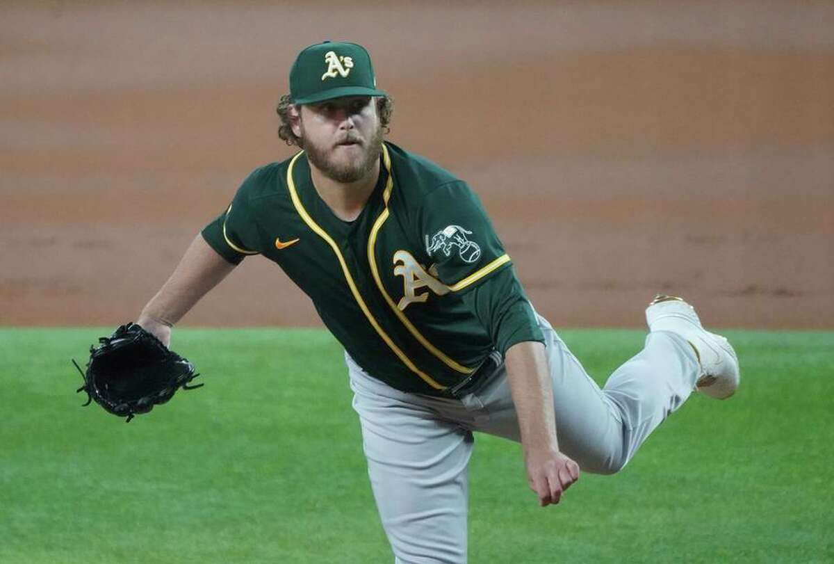 Oakland Athletics starting pitcher Cole Irvin throws against the Texas Rangers in a baseball game Tuesday, June 22, 2021, in Arlington, Texas. (AP Photo/Louis DeLuca)