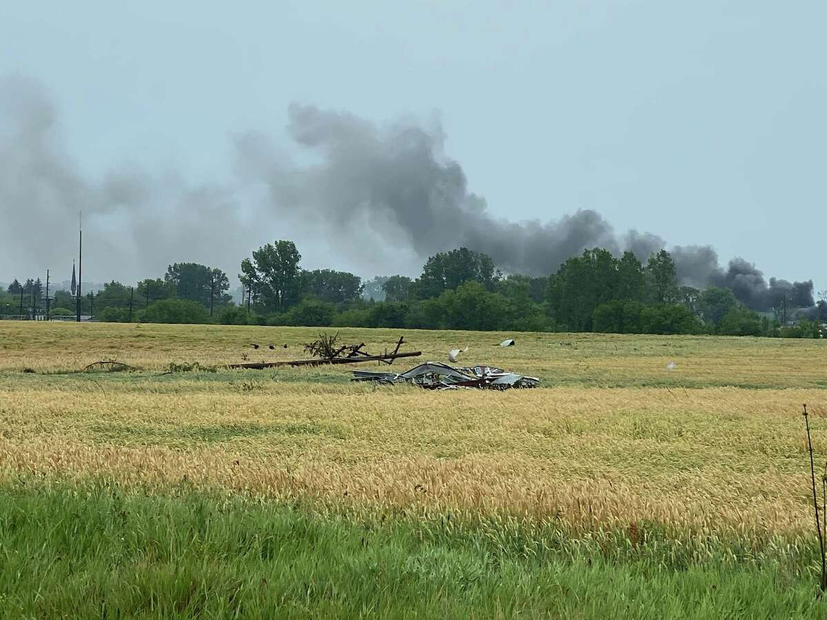 A plume of smoke rises above the horizon outside Port Austin, where there is reports of a possible tornado touchdown June 26.