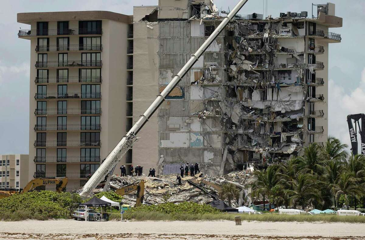 SURFSIDE, FLORIDA - JUNE 26: Members of the South Florida Urban Search and Rescue team look for possible survivors in the partially collapsed 12-story Champlain Towers South condo building on June 26, 2021 in Surfside, Florida. Over 150 people are being reported as missing as search-and-rescue efforts continue with rescue crews from across Miami-Dade and Broward counties. (Photo by Joe Raedle/Getty Images)