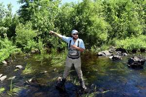 Jon Vander Werff, fish biologist with Save the Sound, stands in the West River in New Haven on June 23, 2021 in front of where the Pond Lily dam once stood.