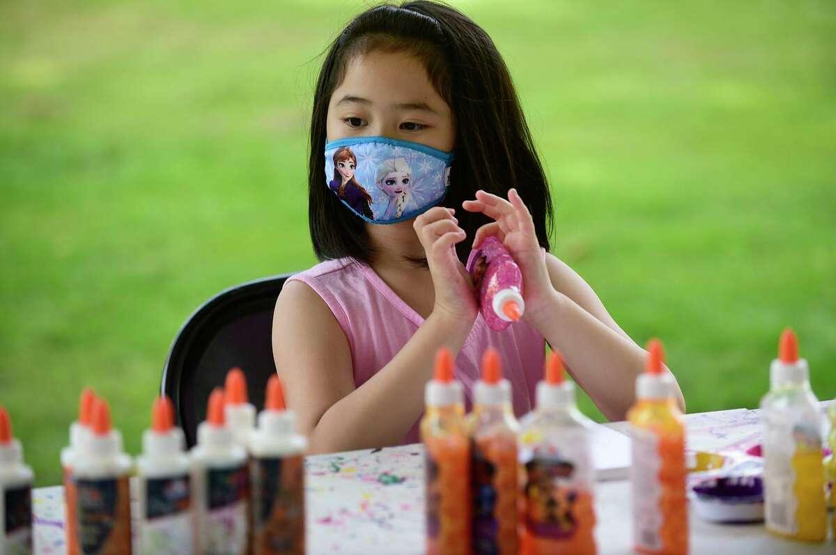 Zoe Wong, 8, makes art at the Artivity Tent sponsored by Jerry's Artarama during the Norwalk Art Festival.