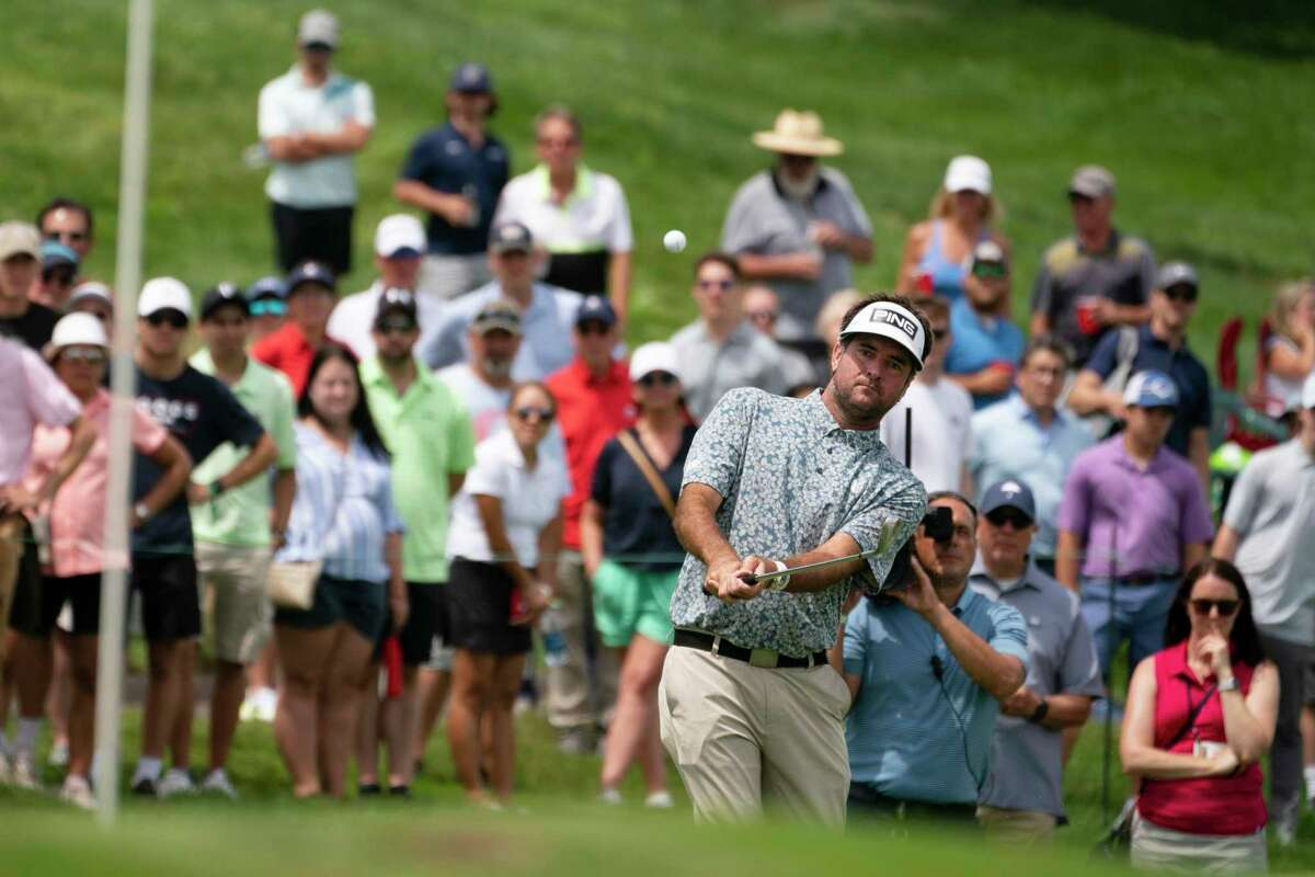 Bubba Watson hits onto the first green during the third round of the Travelers Championship on Saturday.