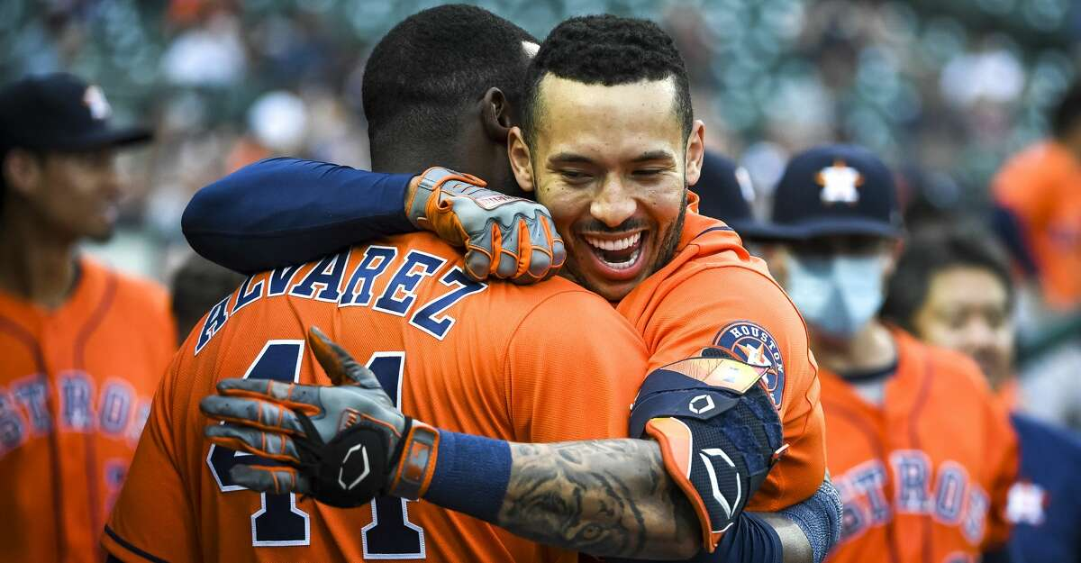 Carlos Correa #1 of the Houston Astros celebrates with Yordan Alvarez #44 of the Houston Astros after Correa hit a homer on a line drive to left field during the top of the sixth inning of game two of a doubleheader at Comerica Park on June 26, 2021 in Detroit, Michigan. (Photo by Nic Antaya/Getty Images)