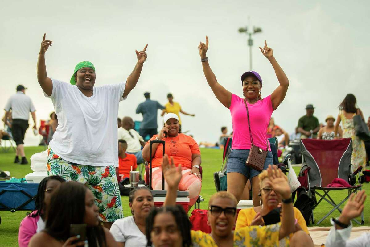 """The crowd celebrates and dances before KTSU's """"Keeping Music Alive"""" concert at Miller Outdoor Theatre on Saturday. The station, believed to have the largest African American audience of any public radio station in the U.S., is preparing to celebrate its 50th anniversary next year."""