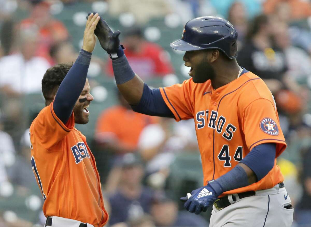 Houston Astros' Yordan Alvarez (44) celebrates with Jose Altuve after hitting a two-run home run that scored the pair during the sixth inning of the second baseball game of a doubleheader against the Detroit Tigers, Saturday, June 26, 2021, in Detroit. (AP Photo/Duane Burleson)