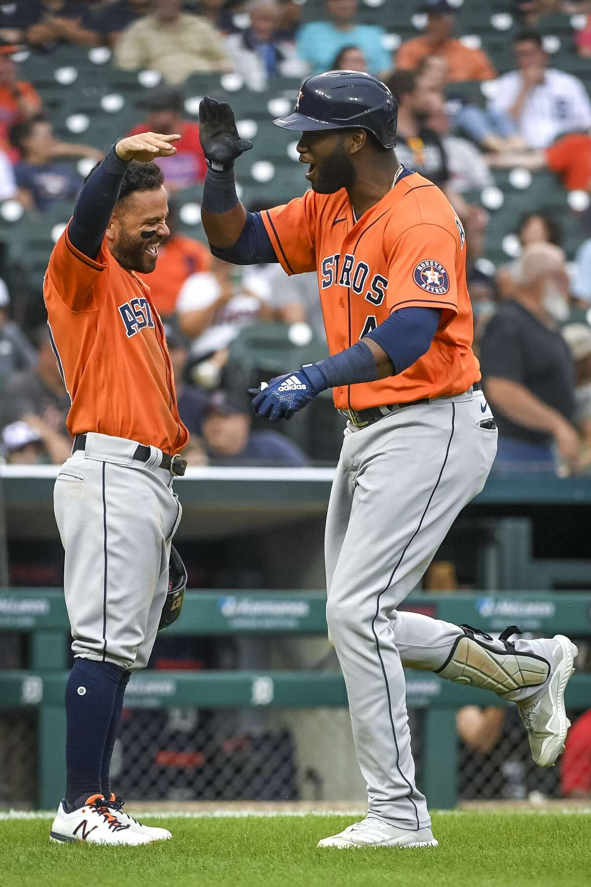 DETROIT, MICHIGAN - JUNE 26: Jose Altuve #27 of the Houston Astros celebrates with Yordan Alvarez #44 of the Houston Astros after Alvarez hit a homer and Altuve scored during the top of the sixth inning of game two of a doubleheader at Comerica Park on June 26, 2021 in Detroit, Michigan. (Photo by Nic Antaya/Getty Images)