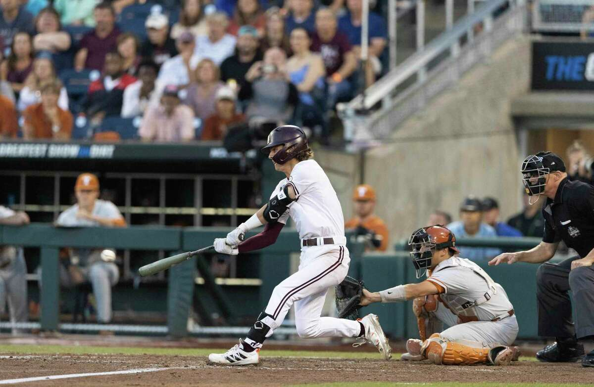 Mississippi State's Tanner Leggett hits an RBI-walkoff single to defeat Texas in the ninth inning of a baseball game in the College World Series, Saturday, June 26, 2021, at TD Ameritrade Park in Omaha, Neb. (AP Photo/Rebecca S. Gratz)