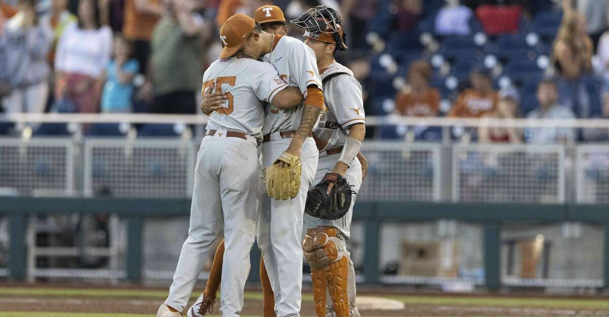 Texas' Cam Williams, left, hugs Cole Quintanilla following their loss to Mississippi State in a baseball game in the College World Series, Saturday, June 26, 2021, at TD Ameritrade Park in Omaha, Neb. (AP Photo/Rebecca S. Gratz)