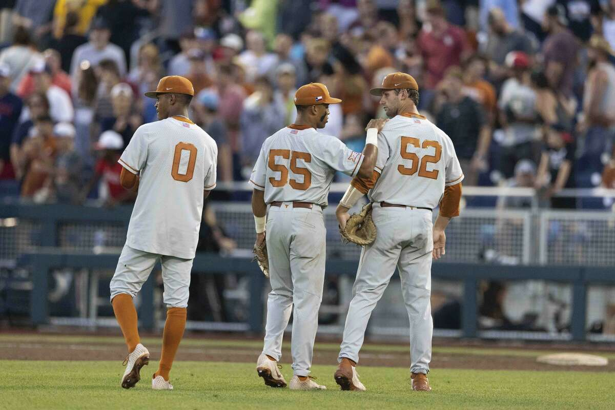 From left to right, Texas' Trey Faltine (0), Cam Williams (55) and Zach Zubia (52) react after their loss to Mississippi State in a baseball game in the College World Series, Saturday, June 26, 2021, at TD Ameritrade Park in Omaha, Neb. (AP Photo/Rebecca S. Gratz)