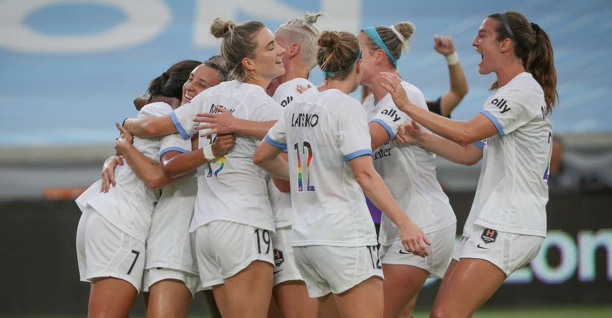 Houston Dash forward Maria Sanchez (7), left, receives hugs from her teammates after scoring a goal during the first half match at BBVA Compass Stadium on Saturday, June 26, 2021, in Houston.